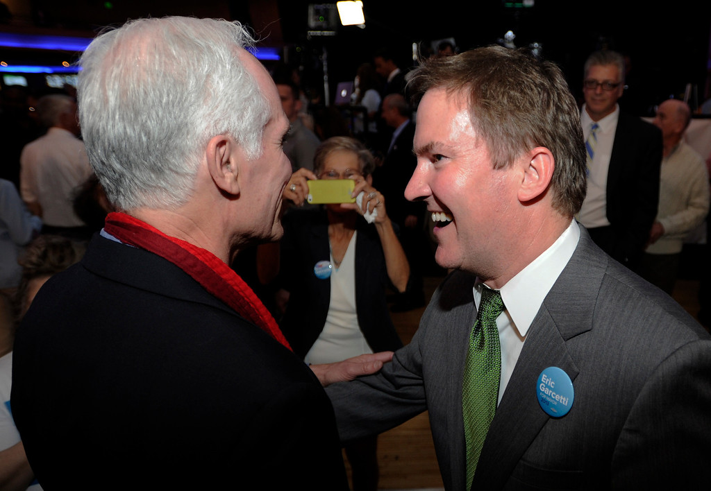 . Gil Garcetti, father of Eric, talks with former candidate for Mayor Kevin James. Los Angeles Mayoral candidate Eric Garcetti poses for photos after his speech. Garcetti held his election night party at The Hollywood Palladium where supporters showed hear him speak. Hollywood, CA 5/22/2013(John McCoy/LA Daily News)
