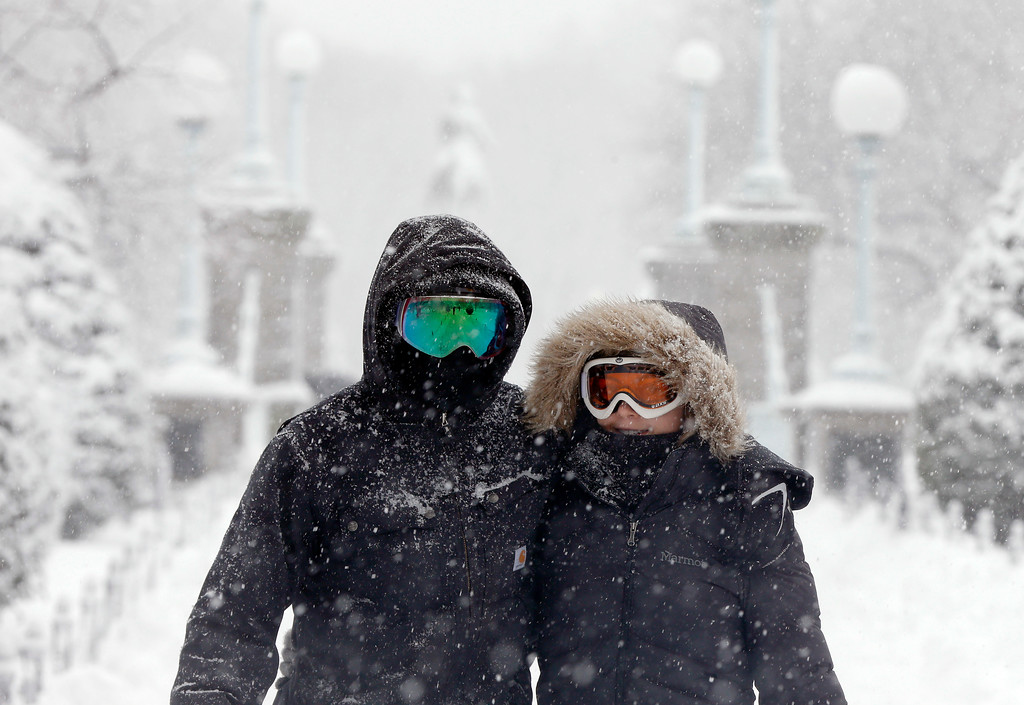 . A couple wear goggles during a snowstorm, Tuesday, March 13, 2018, in Boston. (AP Photo/Michael Dwyer)