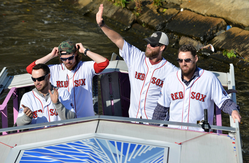 . Boston Red Sox players, from left, Daniel Nava, Clay Buccholz, Matt Thornton and John Lackey float along the Charles River in an amphibious duck boat during a victory parade celebrating the team\'s World Series title Saturday, Nov. 2, 2013, in Cambridge, Mass. (AP Photo/Josh Reynolds)