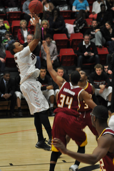 Tashan Newsome takes a shot against Winthrop University Tuesday February 19, 2013.