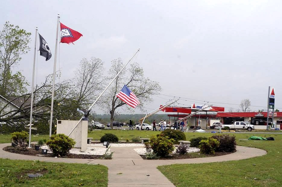 Description of . In this handout provided by the Arkansas National Guard, an American Flag flies at half-staff on a wind bent pole in front of the community center following a deadly tornado April 28, 2014 in Vilonia, Arkansas. Arkansas National Guard members continue to respond to emergency declared disaster areas within the state of Arkansas. At least 11 people were killed Monday after a tornadoes touched down in Alabama, Mississippi and Tennessee, bringing the overall death toll from two days of severe weather to at least 28.  (Photo by Arkansas National Guard via Getty Images)