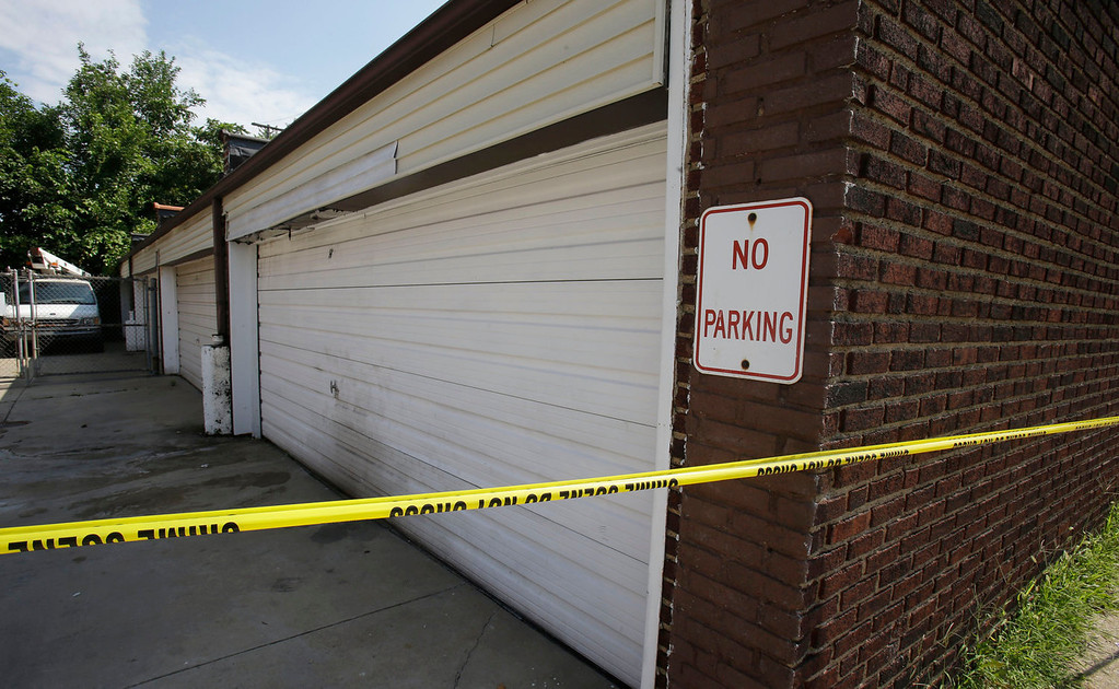 . A garage is shown Sunday, July 21, 2013, where a body was found recently in East Cleveland, Ohio.  The bodies, believed to be female, were found about 100 to 200 yards (90 to 180 meters) apart, and a 35-year-old man was arrested and is a suspect in all three deaths, though he has not yet been charged, East Cleveland Mayor Gary Norton said Saturday. (AP Photo/Tony Dejak)