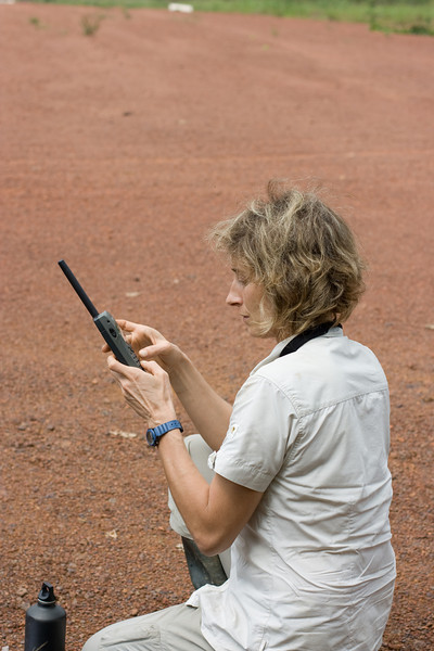 Stephanie sending a satellite phone text message.