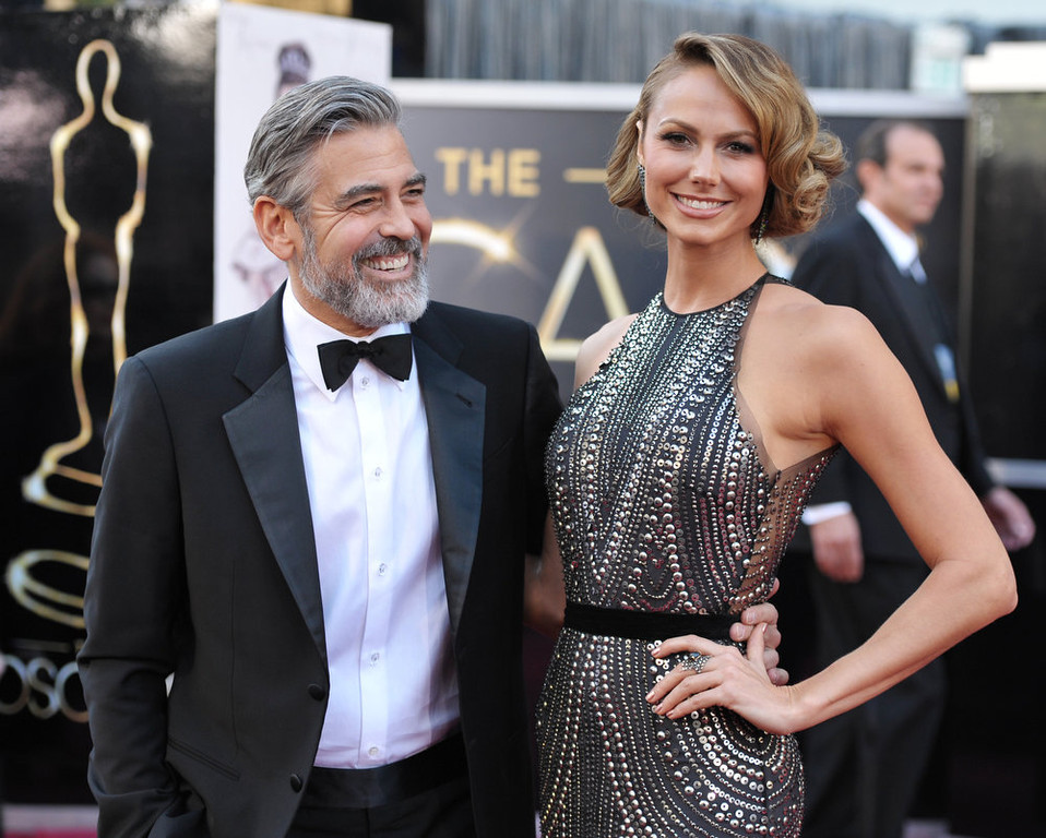. Actor George Clooney, left, and Stacy Keibler arrive at the Oscars at the Dolby Theatre on Sunday Feb. 24, 2013, in Los Angeles. (Photo by John Shearer/Invision/AP)