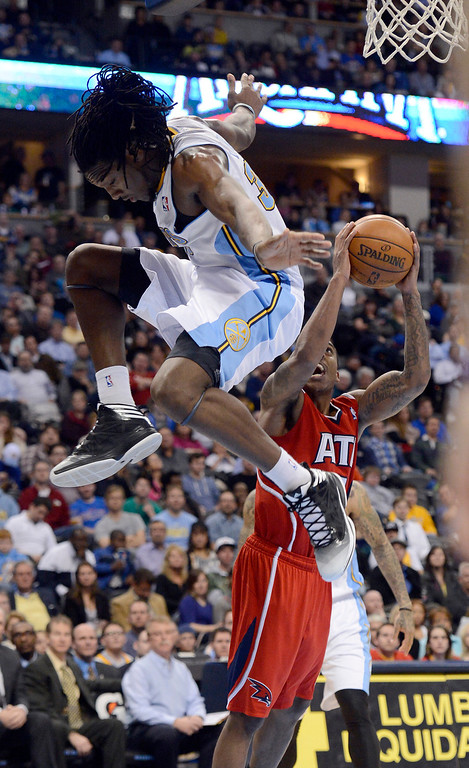. Kenneth Faried (35) of the Denver Nuggets sails past Jeff Teague (0) of the Atlanta Hawks as he takes a shot during the fourth quarter March 4,  2013 at Pepsi Center. The Denver Nuggets defeated the Atlanta Hawks, 104-88. (Photo By John Leyba/The Denver Post)