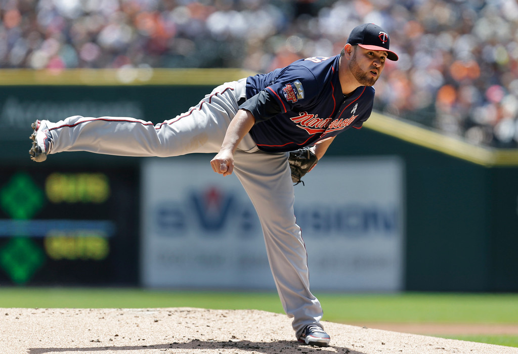 . Minnesota Twins pitcher Ricky Nolasco throws against the Detroit Tigers in the first inning of a baseball game in Detroit, Sunday, June 15, 2014. (AP Photo/Paul Sancya)