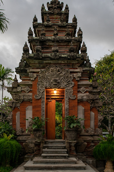 The ornate carved doors and entrance into the cultural hindu temple in Bali at night