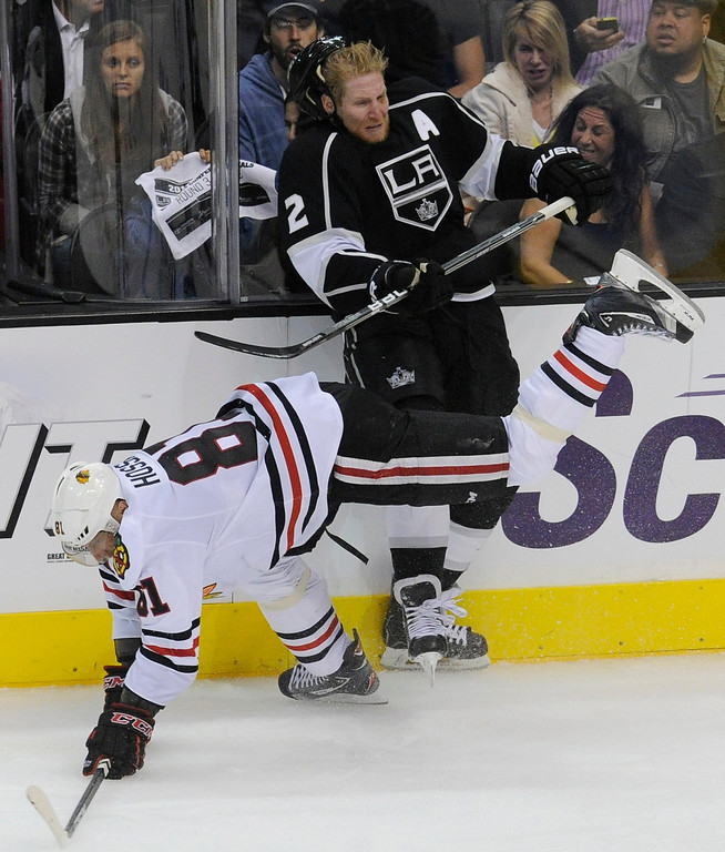 . Kings#2 Matt Greene gets checked by Blackhawks#81 Marian Hossa in the 3rd period. The Kings defeated the Chicago Blackhawks in the 3-1 in the 3rd game of the Western Conference Finals. Los Angeles, CA 6/4/2013(John McCoy/LA Daily News4