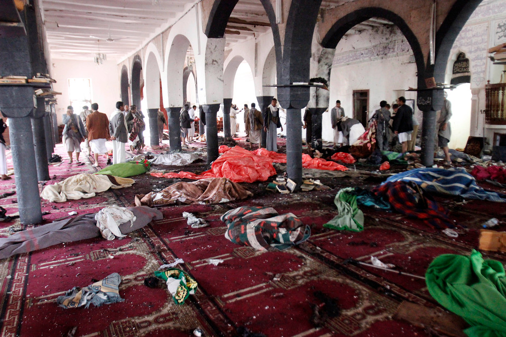 . Bodies of people killed in a suicide attack during the noon prayer are covered in blankets in a mosque in Sanaa, Yemen, Friday, March 20, 2015. Triple suicide bombers hit a pair of mosques crowded with worshippers in the Yemeni capital, Sanaa, on Friday, causing heavy casualties, according to witnesses. The attackers targeted mosques frequented by Shiite rebels, who have controlled the capital since September. (AP Photo/Hani Mohammed)