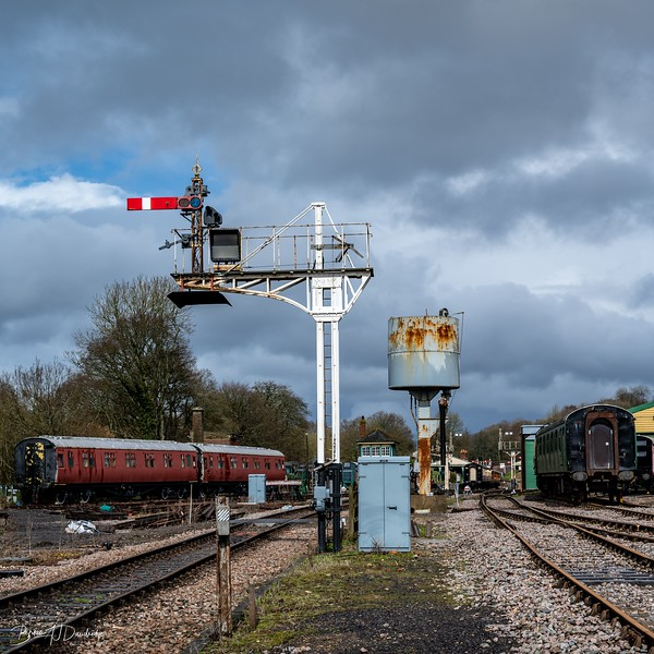A signal gantry and water-tower at Horsted Keynes