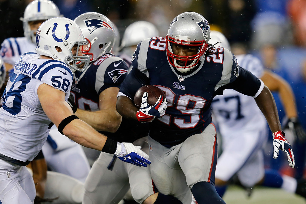 . FOXBORO, MA - JANUARY 11:   LeGarrette Blount #29 of the New England Patriots runs the ball against  Andy Studebaker #58 of the Indianapolis Colts during the AFC Divisional Playoff game at Gillette Stadium on January 11, 2014 in Foxboro, Massachusetts.  (Photo by Jim Rogash/Getty Images)
