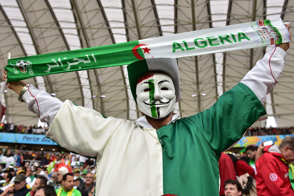 . An Algeria fan cheers during the Round of 16 football match between Germany and Algeria at Beira-Rio Stadium in Porto Alegre during the 2014 FIFA World Cup on June 30, 2014.    GABRIEL BOUYS/AFP/Getty Images