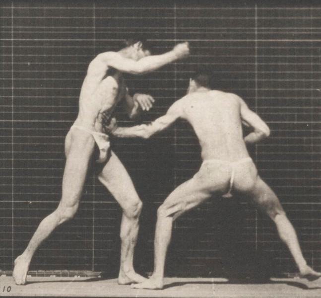 Two men in pelvis clothes boxing