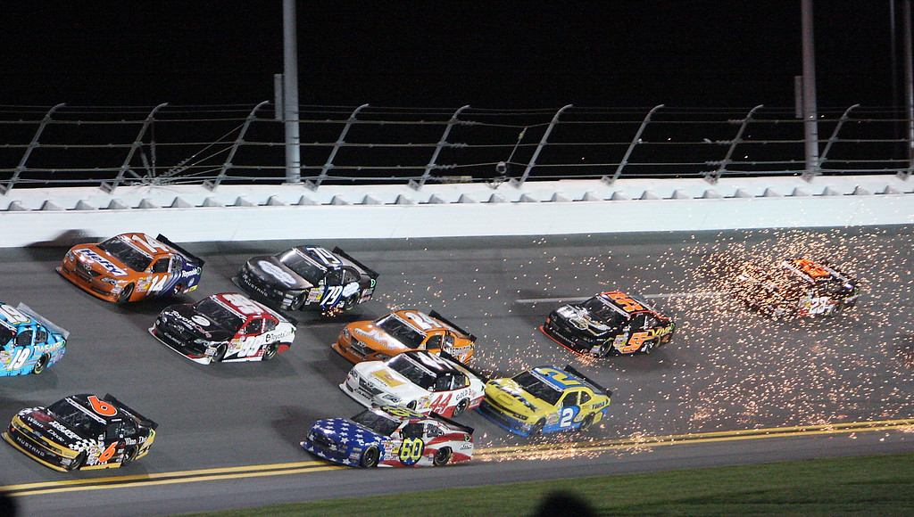 . Travis Pastrana (60) gets loose in turn 4 causing a multi car crash in the NASCAR Nationwide auto race at Daytona International Speedway, Friday, July 5, 2013, in Daytona Beach, Fla. (AP Photo/Darryl Graham)