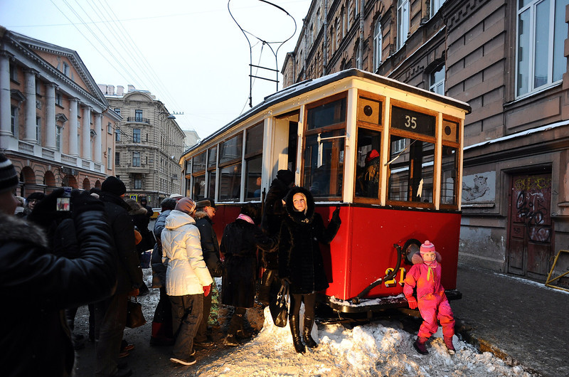. Visitors crowd near a WWII-era tramway displayed at an outdoor exhibition to mark the 70th anniversary of the final raise of the Nazi blockade of the city Leningrad, now St. Petersburg, on January 25, 2014. The German and Finnish siege and blockade of Leningrad was broken on January 18, 1943 but finally lifted a year after, on January 27, 1944. The city\'s name was changed back from Leningrad to St. Petersburg after the 1991 Soviet collapse. AFP PHOTO / OLGA MALTSEVAOLGA MALTSEVA/AFP/Getty Images