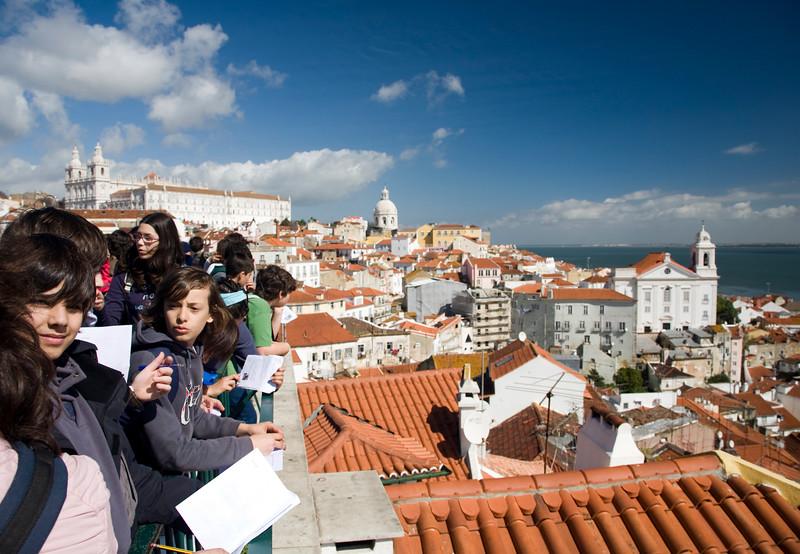Portuguese students looking at Lisbon from Santa Luzia viewpoint.