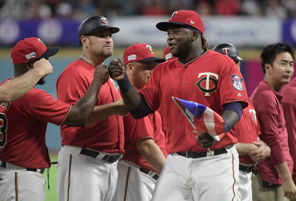 . CORRECTS RIVAL TEAM TO CLEVELAND INDIANS - Minnesota Twins infielder Miguel Sano enters the field moments before game one of a two-game MLB Series against the Cleveland Indians at Hiram Bithorn Stadium in San Juan, Puerto Rico, Tuesday, April 17, 2018. (AP Photo/Carlos Giusti)