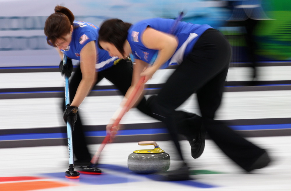 . Allison Pottinger (L) and Natalie Nicholson of USA brush the ice during the Women\'s Curling Round Robin match between Russia and USA on day 8 of the Vancouver 2010 Winter Olympics at the Vancouver Olympic Centre on February 19, 2010 in Vancouver, Canada.  (Photo by Alex Livesey/Getty Images)