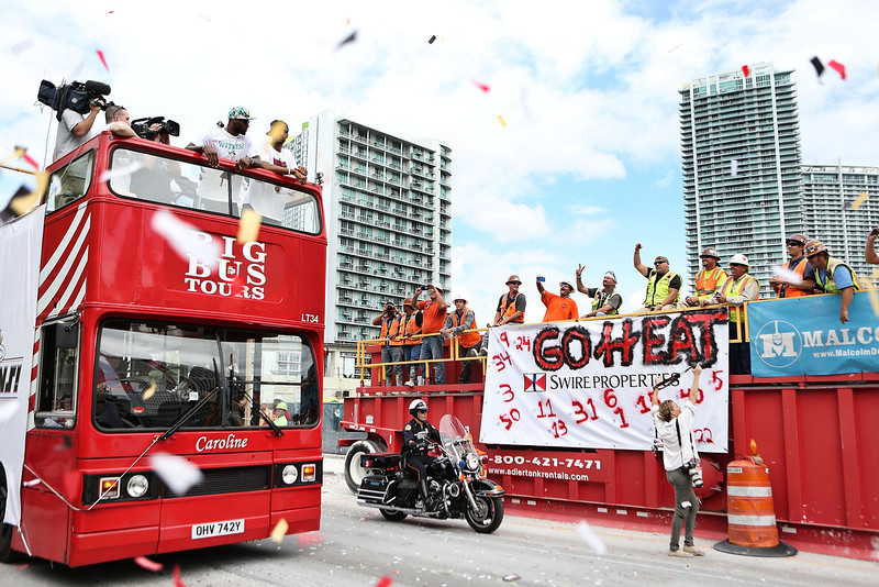 . Forward Lebron James #6 of the Miami Heat rides a bus during the Championship victory parade on the streets on June 24, 2013 in Miami, Florida. The Miami Heat defeated the San Antonio Spurs in the NBA Finals. (Photo by Marc Serota/Getty Images)