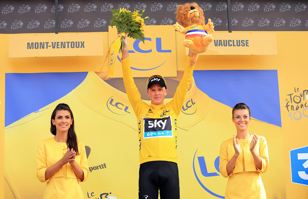 . Current race leader and wearer of the Maillot Jaune, Chris Froome of Great Britain and SKY Procycling celebrates on the podium after winning stage fifteen of the 2013 Tour de France, a 242.5KM road stage from Givors to Mont Ventoux, on July 14, 2013 on Mont Ventoux, France.  (Photo by Doug Pensinger/Getty Images)