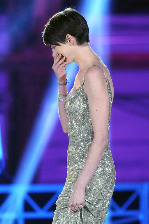 """. Actress Anne Hathaway accepts the Best Supporting Actress Award for \""""Les Miserables\"""" onstage at the 18th Annual Critics\' Choice Movie Awards held at Barker Hangar on January 10, 2013 in Santa Monica, California.  (Photo by Kevin Winter/Getty Images)"""