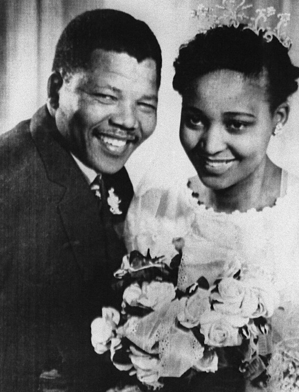 . South African anti-apartheid leader and member of the African National Congress (ANC) Nelson Mandela shown in a file photo dated 1957 posing with his wife Winnie during their wedding. (Photo credit should read OFF/AFP/Getty Images)