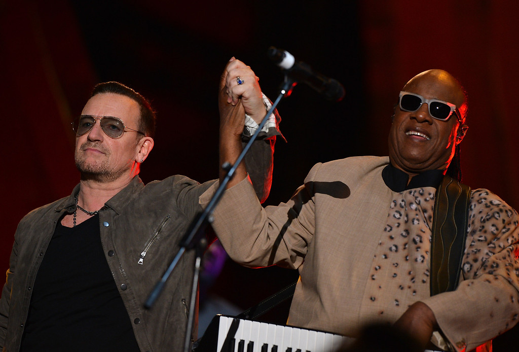 . NEW YORK, NY - SEPTEMBER 28: Bono and Stevie Wonder perform at the 2013 Global Citizen Festival in Central Park to end extreme poverty on September 28, 2013 in New York City, New York.  (Photo by Stephen Lovekin/Getty Images for Global Citizen Festival)