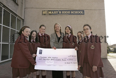 Pupils from St Mary's high school Newry present Emma trainor from Southern Area Hospicewith a cheque for £1300 which was raised through Number day at the school. 06W8N3