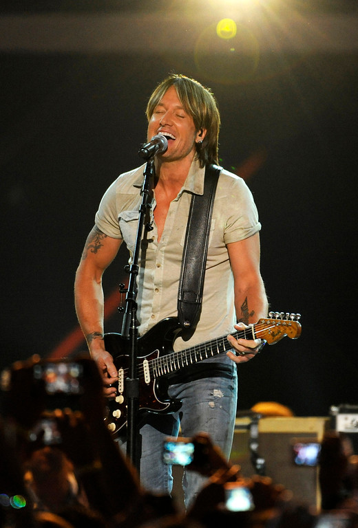 . Keith Urban performs at the 2013 CMT Music Awards at Bridgestone Arena on Wednesday, June 5, 2013, in Nashville, Tenn. (Photo by Donn Jones/Invision/AP)