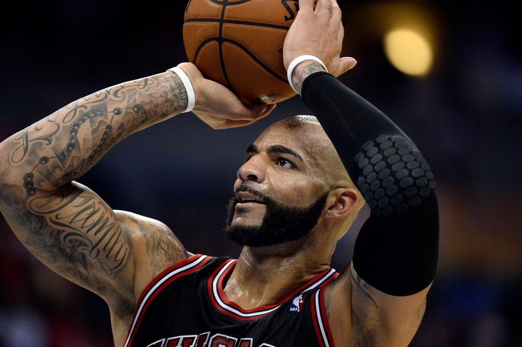 . Chicago Bulls power forward Carlos Boozer (5) shoots a free throw during the third quarter against the Denver Nuggets November 21, 2013 at Pepsi Center. (Photo by John Leyba/The Denver Post)