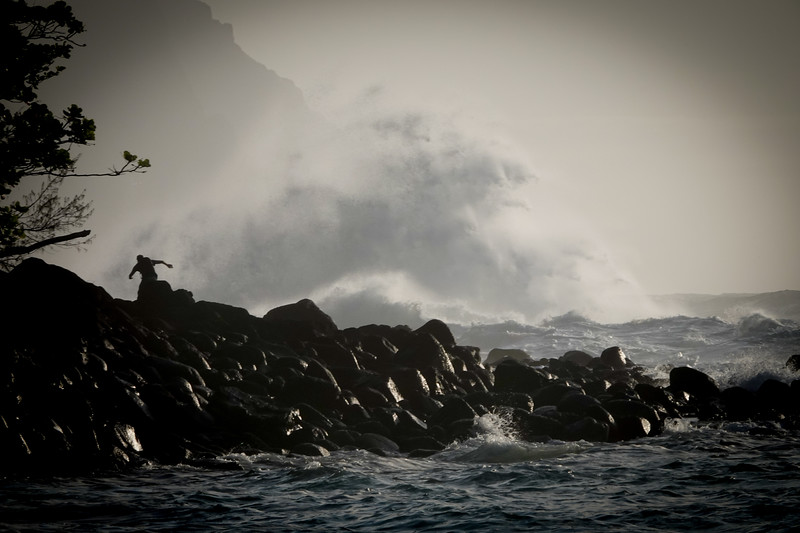 At the end of the Kauai island, cars come to a stop, and the only way to see the rest of the Nap'li coast is by boat or helipcopter. Here a photographer hopes for a great shot, and is ducking the big waves