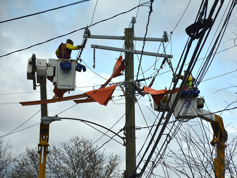 4/21/2015 Mike Orazzi | Staff Eversource workers replace a pole on South Street extension on Tuesday afternoon.