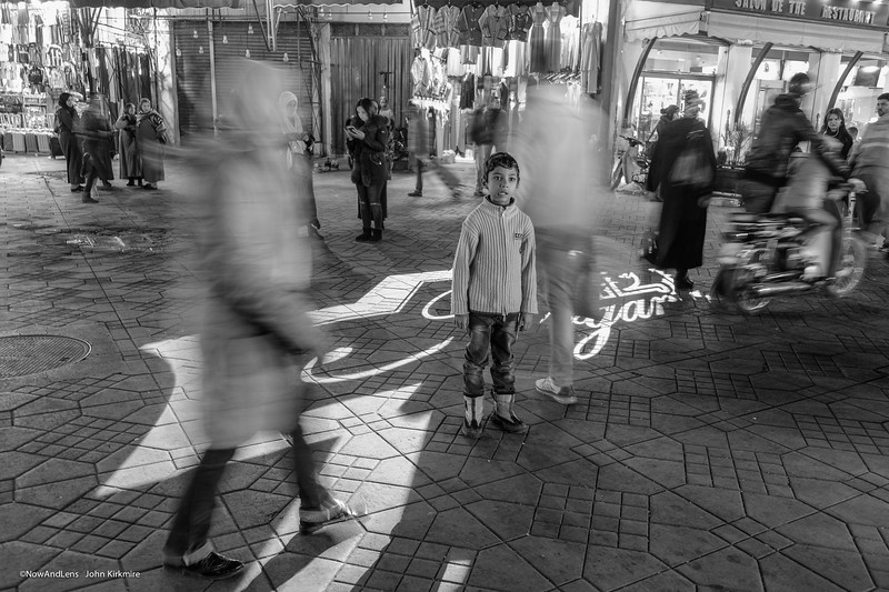 Marrakesh night market, boy waiting