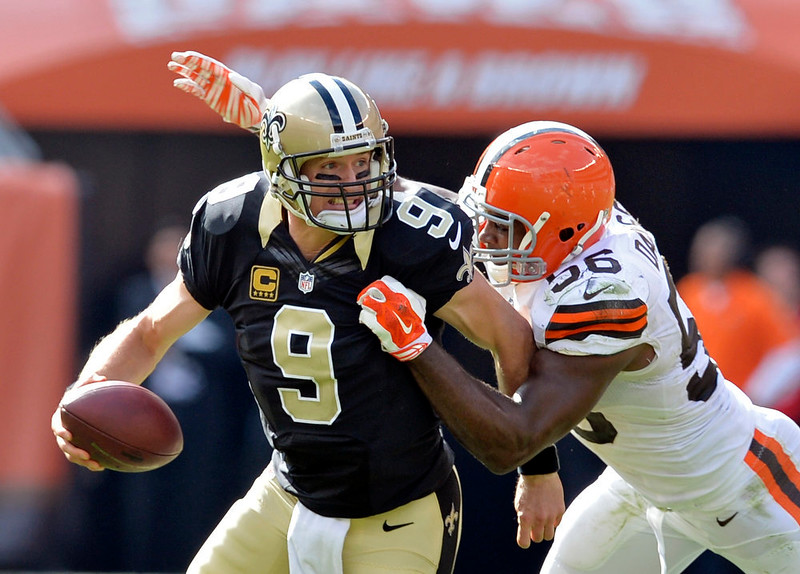 . Cleveland Browns linebacker Karlos Dansby (56) sacks New Orleans Saints quarterback Drew Brees in the fourth quarter of an NFL football game Sunday, Sept. 14, 2014, in Cleveland. (AP Photo/David Richard)