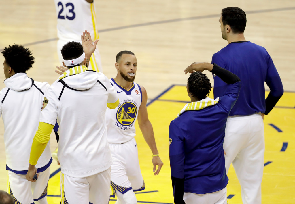 . Golden State Warriors guard Stephen Curry (30) celebrates with teammates during the second half of Game 1 of basketball\'s NBA Finals between the Warriors and the Cleveland Cavaliers in Oakland, Calif., Thursday, May 31, 2018. (AP Photo/Marcio Jose Sanchez)