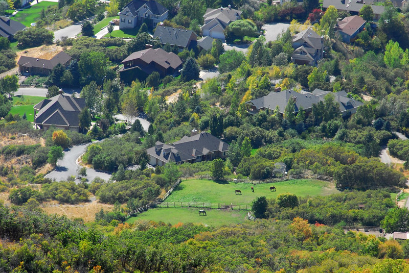 9/30/07 – This is a shot looking down on the Provo bench where all the rich people live. These are big homes. The horses in the green pasture are what actually caught my attention. You can also see that the fall colors are creeping down to the valley.
