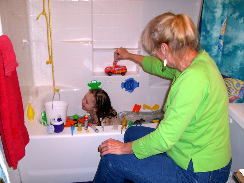 Grandmama Carol playing with Kimber in the bath.