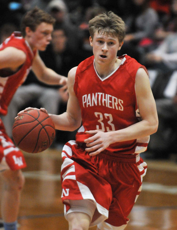 . Lakeville North\'s JP Macura brings the ball up the floor in the first half. Macura was the high scorer in the game with 24 points. (Pioneer Press: Scott Takushi)