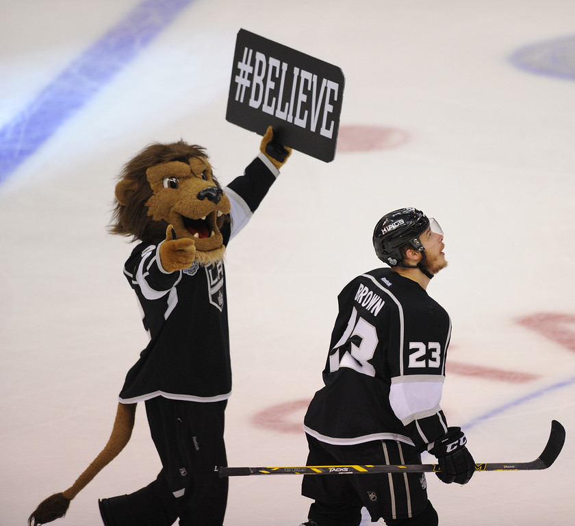 . Kings\' mascot Bailey believes in Dustin Brown (#23) after Brown scored the winning goal in the second overtime to beat the Rangers 5-4 in game two of the Stanley Cup Final, Saturday, June 7, 2014, at Staples Center. (Photo by Michael Owen Baker/Los Angeles Daily News)