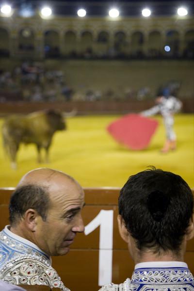 Assistat bullfighters talking during a bullfight at Real Maestranza bullring, Seville, Spain, 15 August 2006.