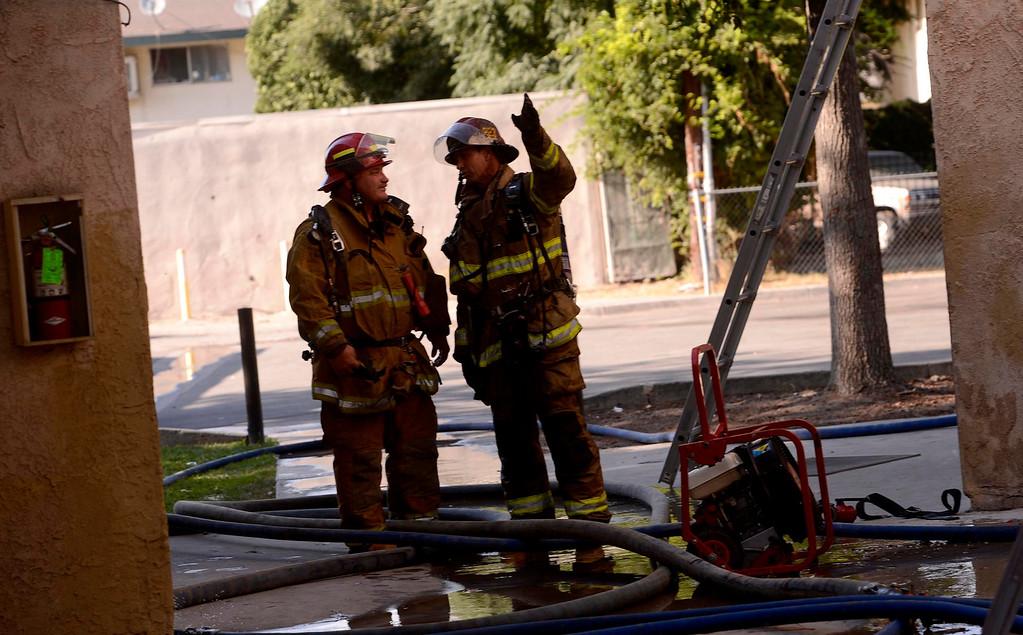 . A scene of a four-alarm fire along the 700 block of Seventh Street in San Bernardino August 18, 2013. GABRIEL LUIS ACOSTA/STAFF PHOTOGRAPHER.