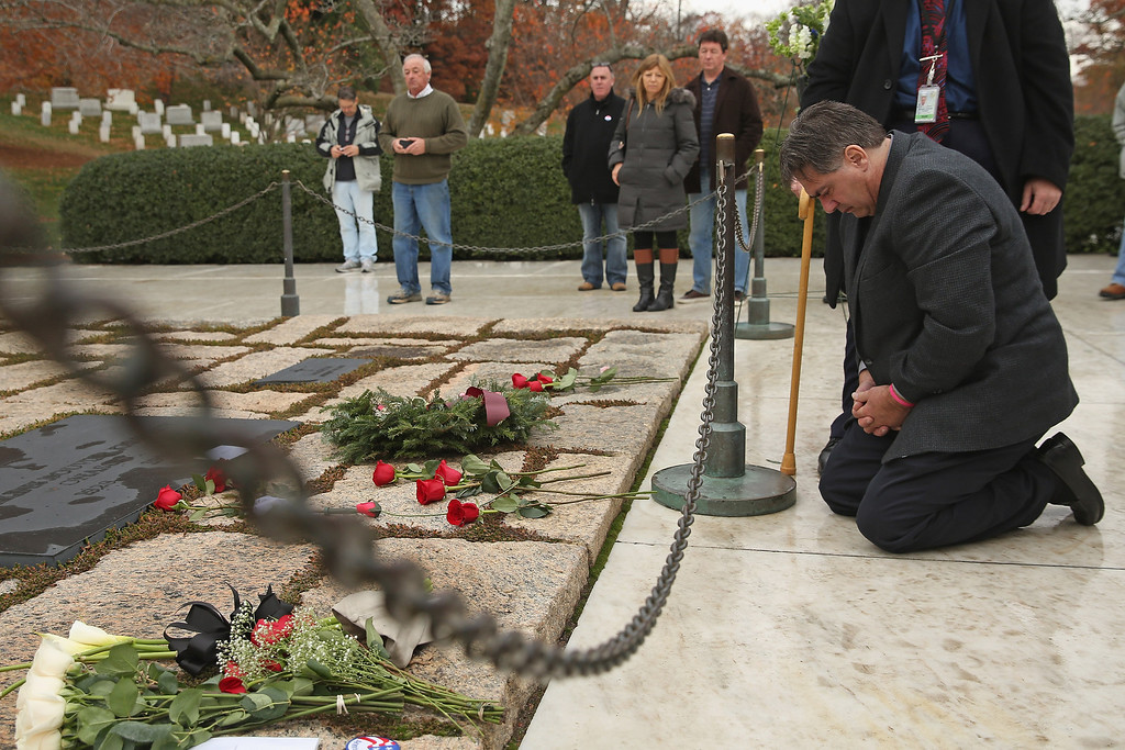 . Herman Whalen Jr. of Syracuse, New York, kneels at the gravesite of former U.S. President John F. Kennedy, his wife Jaqueline Kennedy and other family members at Arlington National Cemetery November 22, 2013 in Arlington, Virginia. When he was a boy in 1963, Whalen and his family laid a wreath at the gravesite. Remembrance ceremonies will be held across the United States today, the 50th anniversary of the assassination of President Kennedy.  (Photo by Chip Somodevilla/Getty Images)