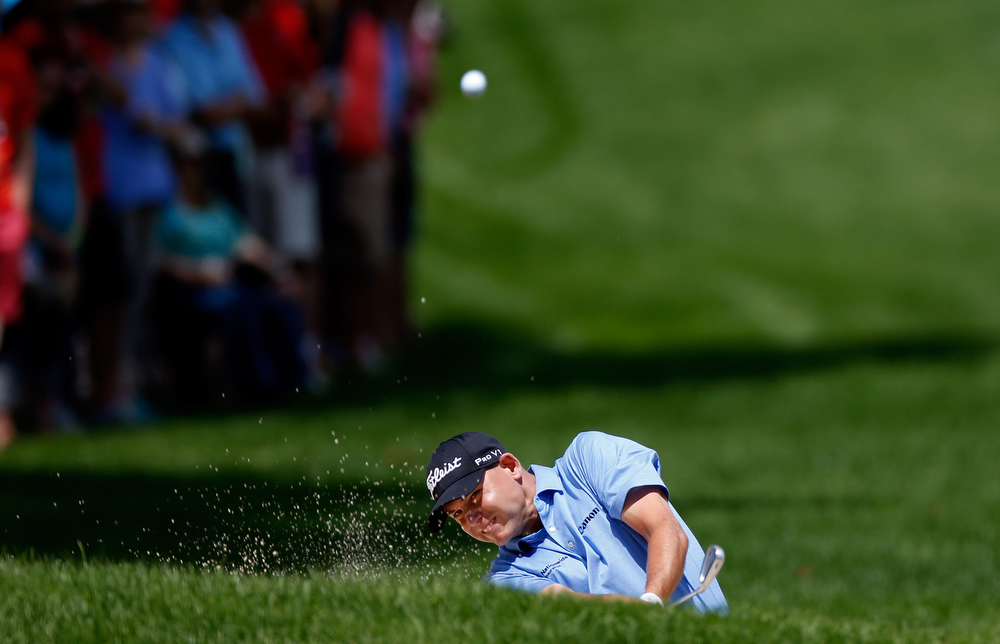 . Bill Haas hits out of a bunker on the first fairway during the Final Round of the World Golf Championships-Bridgestone Invitational at Firestone Country Club South Course on August 4, 2013 in Akron, Ohio.  (Photo by Gregory Shamus/Getty Images)