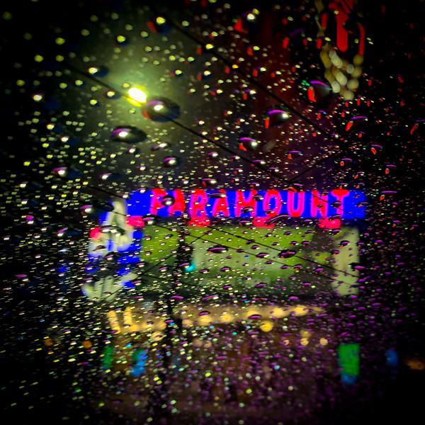 Reflection of the Paramount Theater in the rain