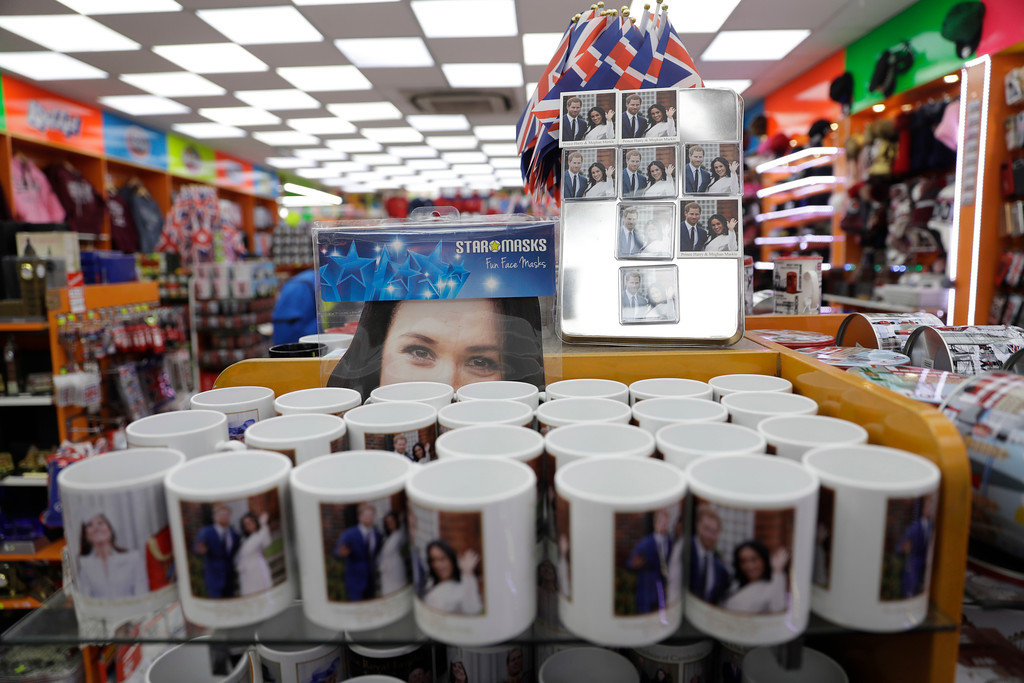 . A Meghan Markle mask and other souvenir items for the upcoming wedding of Britain\'s Prince Harry and Meghan Markle are displayed for sale in a shop in London, Wednesday, March 28, 2018. The wedding takes place on Saturday May 19 in Windsor Castle, England. (AP Photo/Matt Dunham)