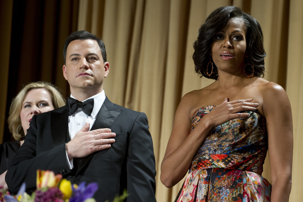 Description of . Television host Jimmy Kimmel (L) alongside First Lady Michelle Obama (R) during the White House Correspondents Association Dinner in Washington, DC, April 28, 2012. The annual event, which brings together Hollywood celebrities, news media personalities and Washington correspondents, features comedian Jimmy Kimmel as the host. AFP PHOTO / Saul LOEBSAUL LOEB/AFP/GettyImages