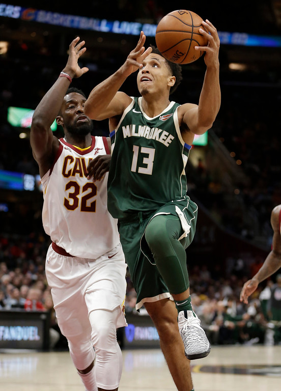 . Milwaukee Bucks\' Malcolm Brogdon (13) drives against Cleveland Cavaliers\' Jeff Green (32) in the second half of an NBA basketball game, Tuesday, Nov. 7, 2017, in Cleveland. (AP Photo/Tony Dejak)