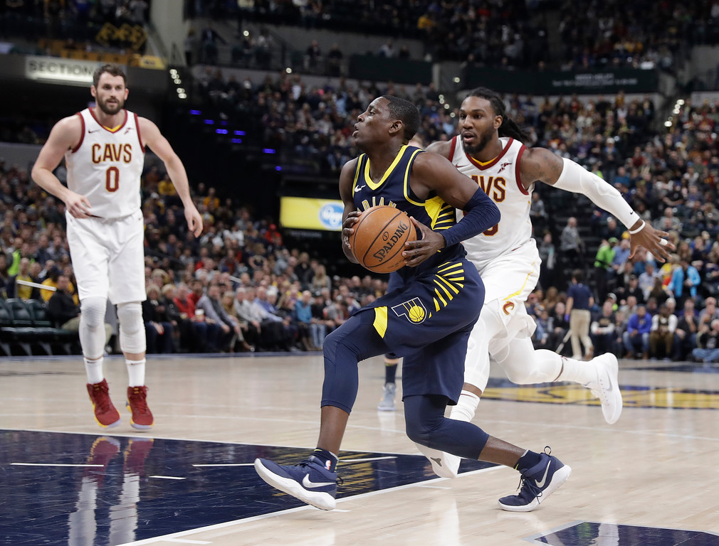 . Indiana Pacers\' Darren Collison, center, goes to the basket against Cleveland Cavaliers\' Jae Crowder during the second half of an NBA basketball game, Friday, Jan. 12, 2018, in Indianapolis. (AP Photo/Darron Cummings)