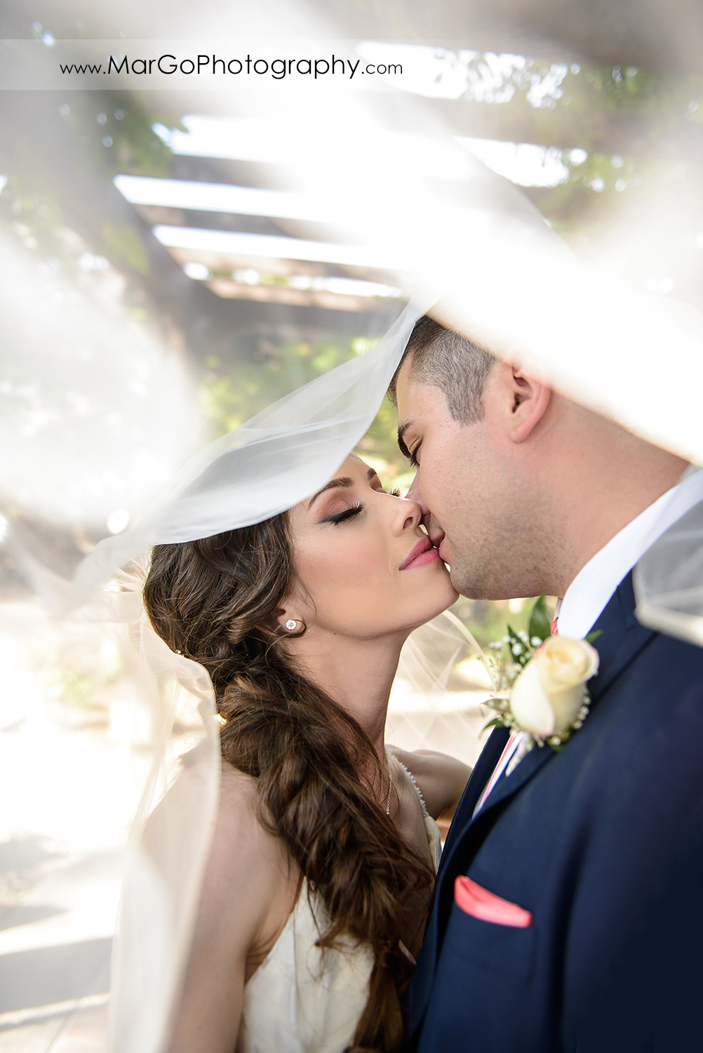 veil shot of bride and groom at Saratoga Foothill Club
