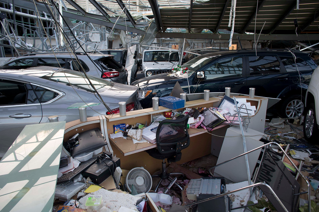 . A view of a car dealership that was heavily damaged by hurricane Odile in San Jose de los Cabos, Mexico, Wednesday, Sept. 17, 2014. After Odile roared past, residents of the resort state of Baja California Sur struggled with a lack of power and running water and formed long lines for emergency supplies. There were scattered reports of looting.  (AP Photo/Dario Lopez-Mills)
